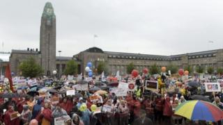 People demonstrate against budget measures proposed by the Finnish government, at the Central Railway Station in Helsinki