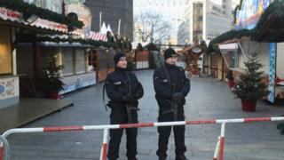 German police stand near site where a man drove a heavy truck into a Christmas market. 21 December 2016