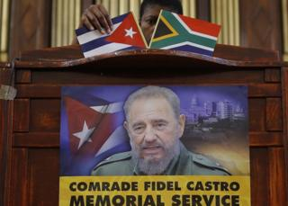 An official prepares the stage prior to a ANC memorial for the late Cuban President Fidel Castro, at the the Johannesburg City Hall, Johannesburg, South Africa - Wednesday 30 November 2016