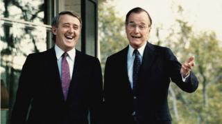 This file photo taken 28 April 1988, shows former US Vice President George Bush (R) as he shares a laugh with Canada's former Prime Minister Brian Mulroney, following a question from a reporter outside Bush's residence in Washington, DC. Mulroney was scheduled to have a second meeting with former US President Ronald Reagan later in the day.