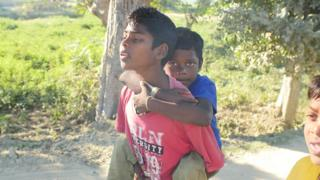 Akash being carried by his brother