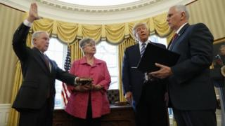 President Donald Trump watches as Vice President Mike Pence administers the oath of office to Attorney General Jeff Sessions.