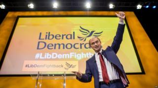 Tim Farron accepting applause after then end of his speech