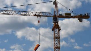 Construction crane with German flag