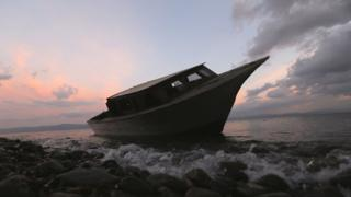 File photo of a boat used by refugees and migrants on a beach in Lesbos