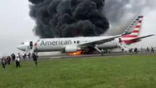 An image taken from a video filmed by a passenger who fled an American Airlines plane after it caught fire at Chicago's O'Hare airport - 28 October 2016