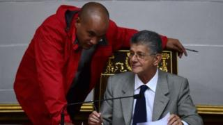 The president of the Venezuelan National Assembly, Henry Ramos Allup (R), listens to Venezuelan deputy Hector Rodriguez, chief of the pro-government legislative bloc, during a session of parliament in Caracas on November 1, 2016.