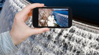 smartphone at a waterfall