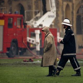 Queen Elizabeth II surveying the scene following the fire at Windsor Castle