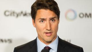 Liberal leader Justin Trudeau speaks to reporters during a press conference following the first federal leaders debate of the 2015 Canadian election campaign in Toronto, August 6, 2015