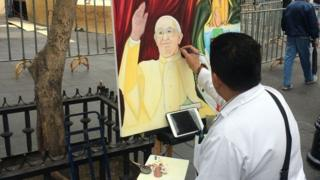 Street painter painting Pope Francis