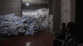 Sacks of WFP aid at a warehouse in Kafr Batna, a rebel-held suburb of Damascus (23 February 2016)