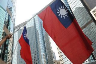 Protestors wave Taiwanese flags in Hong Kong on 17 September 2010.