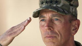 In this July 18, 2011 file photo, Gen. David Petraeus salutes during a changing of command ceremony in Kabul, Afghanistan