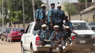 A team of Islamic Sharia enforcers called Hisbah is on patrol in the northern Nigerian city of Kano in an open pickup on 29 October 2013