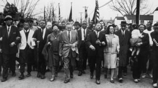 Martin Luther King and wife Coretta Scott King leading a black voting rights march