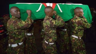 Kenyan soldiers carry the coffin of a colleague killed in Somalia