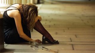 Woman slumped on pavement