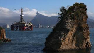 Oil drilling platform in front of Sugarloaf Mountain