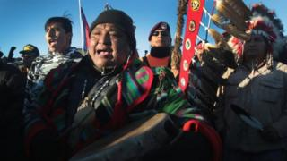 Native American activists celebrate after learning an easement had been denied for the Dakota Access Pipeline at Oceti Sakowin Camp on the edge of the Standing Rock Sioux Reservation