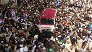 Supporters of Mumtaz Qadri shower rose pastels on an ambulance carrying the body of Qadri for funeral in Rawalpindi, Pakistan, March 1, 2016.