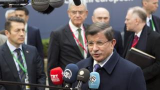 Turkish Prime Minister Ahmet Davutoglu addresses media as he arrives for EU summit in Brussels. 18 March 2016.