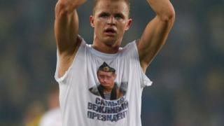 Lokomotiv Moscow's Dmitri Tarasov features an inner shirt with a picture of Russian President Vladimir Putin in Istanbul, Tuesday, Feb. 16, 2016