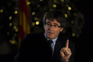 Carles Puigdemont speaks during an interview with The Associated Press in Barcelona, Spain, 16 December
