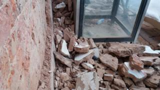 Pile of rubble at sight of Spy Booth artwork