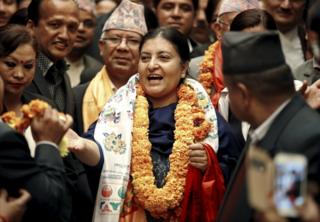 Nepal's newly elected President Bidhya Bhandari (C) walks out from the parliament after she was elected to power in Kathmandu, Nepal 28 October 2015.