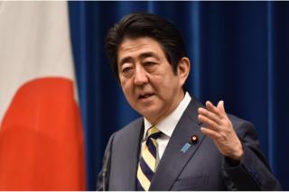 Japan's Prime Minister Shinzo Abe answers questions during his New Year press conference at his official residence in Tokyo on 4 January 2016.