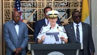 Police Chief Kim Jacobs holds an image of a similar BB gun during a press conference, Sept 15. Courtesy Columbus Dispatch