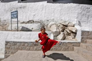 A young monk plays during a break from his studies inside Thiksey Monastery in Ladakh, India.