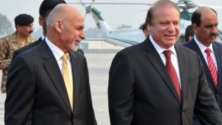 Pakistan's Prime Minister Nawaz Sharif (R) walks with Afghan President Ashraf Ghani (L) upon his arrival at the military Nur Khan airbase in Rawalpindi on December 9, 2015.