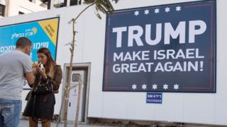 """This file photo taken on November 15, 2016 shows a placard reading """"Trump Make Israel Great Again"""" in Tel Aviv."""