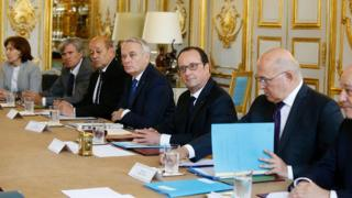 French President Francois Holland surrounded by ministers at the Elysee Palace on 24 June 2016