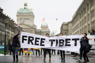 "Pro-Tibet protestors hold a banner reading ""Free Tibet"" during a demonstration, prior to the state visit of Chinese President Xi Jinping in Bern, Switzerland, 15 January 2017."