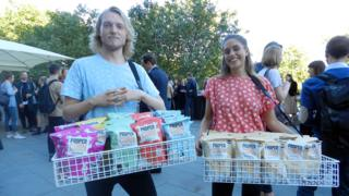 Propercorn workers giving out free popcorn at London Fashion Week