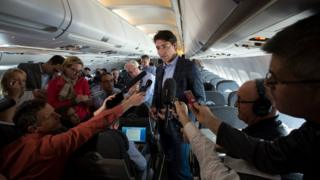 Canada's Prime Minister Justin Trudeau speaks to reporters while flying from Antalya, Turkey to Manila, Philippines on 17 November to attend the APEC Summit.