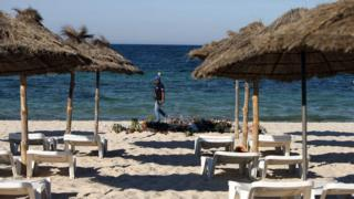 File photo dated 30/06/15 of an armed policeman on the beach near the RIU Imperial Marhaba hotel in Sousse, Tunisia, following a terrorist attack at the beach.