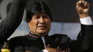 Bolivia's President Evo Morales sings his national anthem at a signing ceremony for the expansion of a road that connects the capital with the nearby city of El Alto, in La Paz, Bolivia, Monday on 22 February, 2016