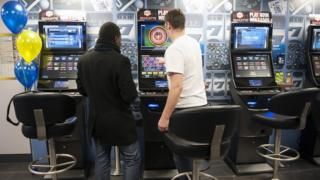 Men play on bound contingency betting terminals