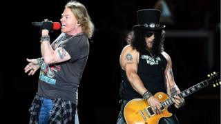 Lead singer Axl Rose (L) and guitarist Slash (R) of US hard rock band Guns N Roses perform in Brisbane, Australia,