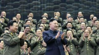 Military officials applaud together with North Korean leader Kim Jong-un, during the Unhasu concert in Pyongyang