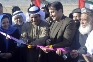 Humayoon Azizi (2-R) the Governor of Kandahar province and Abdullah Mohammed Essa Obaid Al Kaabi (3-R) a top diplomat of the United Arab Emirates (UAE) embassy in Kabul, during a ceremony in Kandahar, Afghanistan, on 10 January 2017.