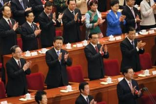 China's President Xi Jinping (2nd row, 2nd L), Premier Li Keqiang (2nd row, 2nd R), Politburo Standing Committee member Liu Yunshan (2nd row, R) and Chairman of the National Committee of the Chinese People's Political Consultative Conference (CPPCC) Yu Zhengsheng (2nd row, L) clap during the closing ceremony of National People's Congress (NPC) at the Great Hall of the People in Beijing, China, 16 March 2016.