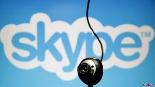 A web camera is seen in front of a Skype logo in this photo illustration taken in Zenica, May 26, 2015