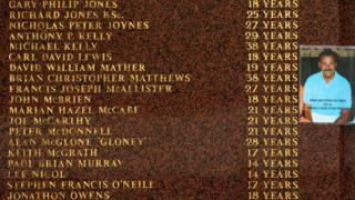 A photograph of Hillsborough victim Brian Christopher Matthews is attached to the Hillsborough memorial outside Anfield