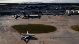 A plane taxis at London Heathrow Airport