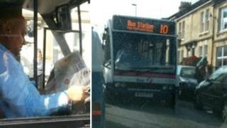 Bus driver reading paper